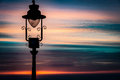 Ornate lamp and sunrise Royalty Free Stock Photo