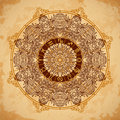 Ornate mandala and zodiac circle with horoscope signs on aged paper background. Royalty Free Stock Photo