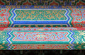 An ornate painted ceiling on a building in the Forbidden City in Beijing Royalty Free Stock Photo
