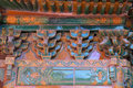 An ornate painted roof on a building in the Forbidden City in Beijing Royalty Free Stock Photo