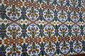 Ornate painted tiles ornated in a spanish tile on a wall Stock Images