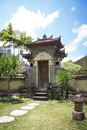 Ornate raised stone gate in tropical garden with stepping stones ubud bali indonesia Stock Image