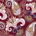 Ornate seamless pattern with paisley and decorative beige swirls on bright burgundy background Stock Image