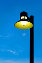 Ornate street light against a blue sky background stock photo Stock Photo