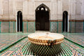 Ornate tiles and fountain in a madrasa Stock Image