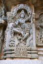 Ornate wall panel reliefs depicting Krishna dancing on the head of serpant Kalia and eventually killing him. Kedareshwara temple, Royalty Free Stock Photo