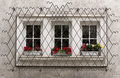 Ornate window security bars windows with decorative metal lattice and flowers Stock Image