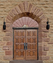 Ornate wooden church door with square carved panels this is the to a samall catholic in durango southern colorado Royalty Free Stock Photography