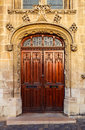 Ornate wooden double door entrance to an old church Royalty Free Stock Photo