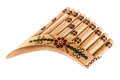 Ornated pan flute a wooden isolated over a white background Royalty Free Stock Image