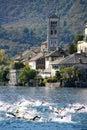 Orta San Giulio island with swimmers Stock Photo