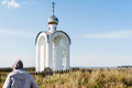 Orthodox chapel white with a transparent facade on the background of the panorama of the sea and blue sky in a field Royalty Free Stock Photo