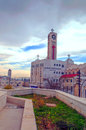 Orthodox church of amman with building in the background on a cloudy day it s a vertical picture Royalty Free Stock Photography