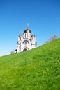 Orthodox Church with golden domes on green hill Royalty Free Stock Photo