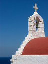 Orthodox church in mykonos cross detail traditional white with the red roof on the island Royalty Free Stock Photo