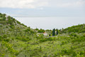 The orthodox church old enclosed by a stone wall with a cemetery inside on shores of skadar lake at montenegro Royalty Free Stock Photo