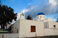 The orthodox church in santorini all on island of s their top is sky blue walls are Stock Photo