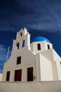 The orthodox church in santorini all on island of s their top is sky blue walls are Royalty Free Stock Images
