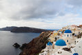 The orthodox church in santorini this angle can see three at same time blue dome of there are two small dome distance Royalty Free Stock Photo