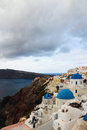 The orthodox church in santorini this angle can see three at same time blue dome of there are two small dome distance Stock Photos