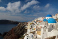 The orthodox church in santorini this angle can see three at same time blue dome of there are two small dome distance Royalty Free Stock Image