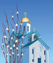 Orthodox church and willow against the blue sky branches with buds Royalty Free Stock Photo