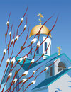 Orthodox church and willow branches against the blue sky with buds Royalty Free Stock Image