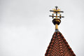Orthodox cross on a church tower with cloudy sky in the background Stock Photography