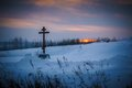 Orthodox cross in a field in winter Royalty Free Stock Photo