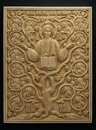 Orthodox icon carved from mammoth Tusk. Royalty Free Stock Photo