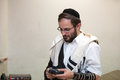 Orthodox cleans the place of tefillin after prayers Royalty Free Stock Photo