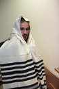 An orthodox jew wears a tallit talit is the religious affiliation of jews pray in it Stock Image