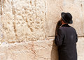 Orthodox jewish man prays at the western wall jerusalem Stock Photos
