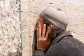 Orthodox jewish man prays at the western wall jerusalem Royalty Free Stock Image