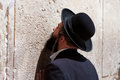 Orthodox jewish man prays at the western wall jerusalem horizontal photo Royalty Free Stock Photo
