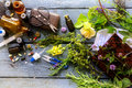 from orthodox medicine to natural medicine, from pills and drops to healing herbs with equipment on a rustic wooden table