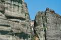Orthodox monastery seen through the cleft in meteora greece an mountain Royalty Free Stock Photo