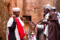 Orthodox priests greeting each other during timkat festival at l two old friends lalibela in ethiopia Royalty Free Stock Photography