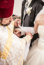 Orthodox tradition of tying hands on wedding Royalty Free Stock Image