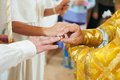 Orthodox wedding ceremony bride and groom hands with ring during church Stock Photo