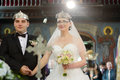 Orthodox wedding ceremony bride and groom kiss at in church Royalty Free Stock Photography