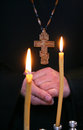 Orthodoxy hands orthodox priest and a cross on a background of candles shallow depth of field Stock Photography