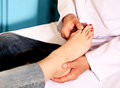 Orthopedic doctor in his office with the model of the feet Royalty Free Stock Photo
