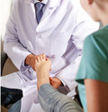 Orthopedic doctor in his office with the model of the feet patient Royalty Free Stock Photos