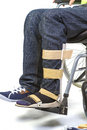 Orthopedic equipment for young man in wheelchair - close up Royalty Free Stock Photo