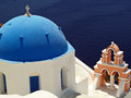 Orthox greek church blue domed orthodox on coastline of santorini island greece Stock Images