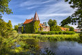 Ortofta castle and moat image of with its public gardens scania sweden Royalty Free Stock Photo