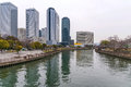 Osaka business park buildings and river in Stock Photography