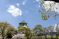 The Osaka Castle with cloud on blue sky and cherry blossom Royalty Free Stock Photo