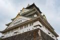 Osaka castle in cloudy sky before the rain fall down